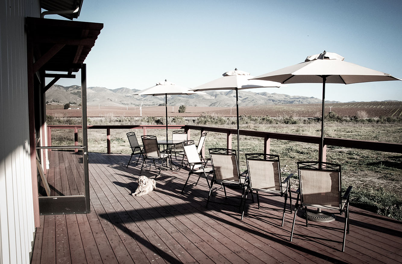 Enjoy wine and a spectacular view at our outside deck.